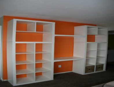 furniture-white-wooden-bookshelves-with-lcd-tv-place-on-grey-carpet-connected-by-orange-wall-eye-catching-decor-bookshelves-for-your-books